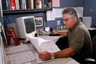 Employee Examining on Charts