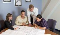 Employees Go Over Floor Plan
