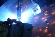 Robotic Arm Welds Metal