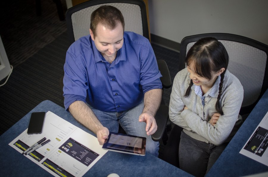 Employees Discussing Handheld Design